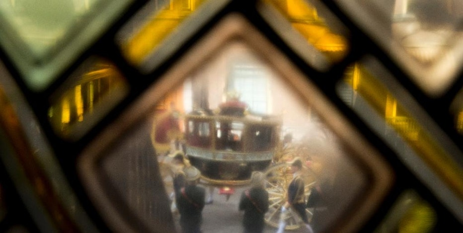 The Glass Carriage carrying Dutch King Willem-Alexander and Queen Maxima is seen through a stained-glass window of the Knight's Hall prior to the King's speech outlining the Dutch government's budget plans for the year ahead in The Hague, Netherlands, Tuesday, Sept. 20, 2016. (AP Photo/Peter Dejong)