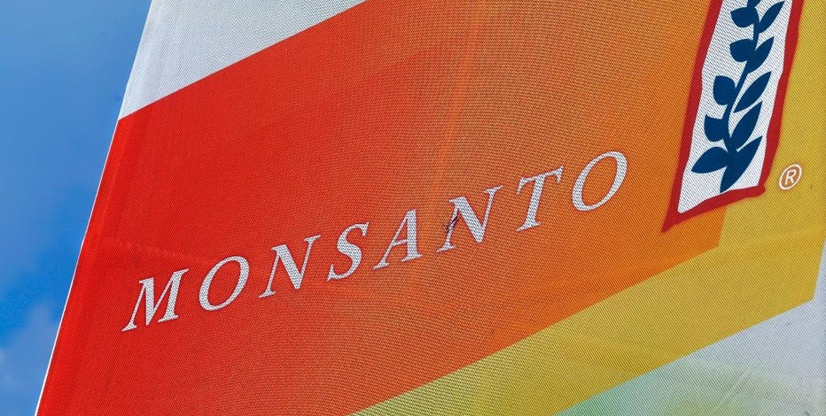 FILE - This Aug. 31, 2015, file photo, shows the Monsanto logo on display at the Farm Progress Show in Decatur, Ill. The Senate is set to take a closer look at a proposed $66 billion merger of American seed and weed-killer company Monsanto and German medicine and farm chemical maker Bayer. (AP Photo/Seth Perlman, File)