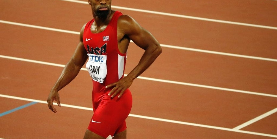 FILE - In this Sunday, Aug. 23, 2015, file photo, United States' Tyson Gay leaves the track after the men's 100-meter final at the World Athletics Championships at the Bird's Nest stadium in Beijing. Olympic sprinter Gay is entered in this week's USA Bobsled National Push Championships, making him the latest track star to give sledding a try. (AP Photo/Mark Schiefelbein, File)