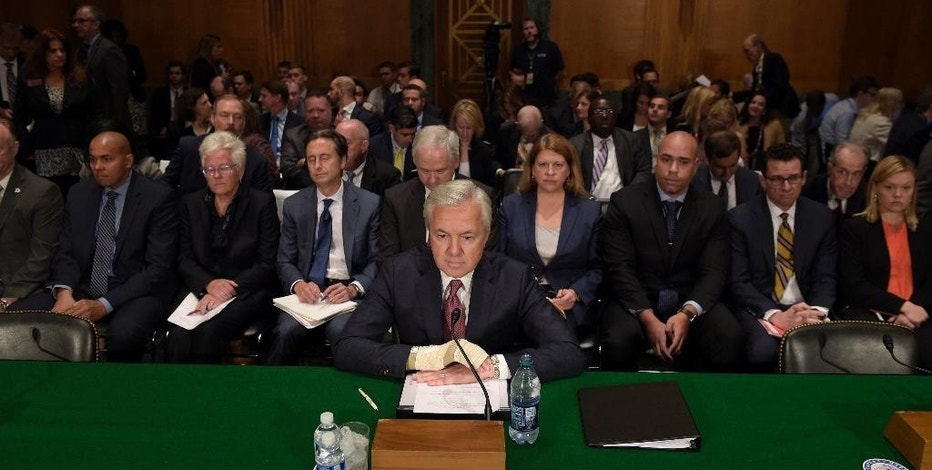Wells Fargo Chief Executive Officer John Stumpf  prepares to testify on Capitol Hill in Washington, Tuesday, Sept. 20, 2016, before Senate Banking Committee. Strumpf was called before the committee for betraying customers' trust in a scandal over allegations that employees opened millions of unauthorized accounts to meet aggressive sales targets. (AP Photo/Susan Walsh)
