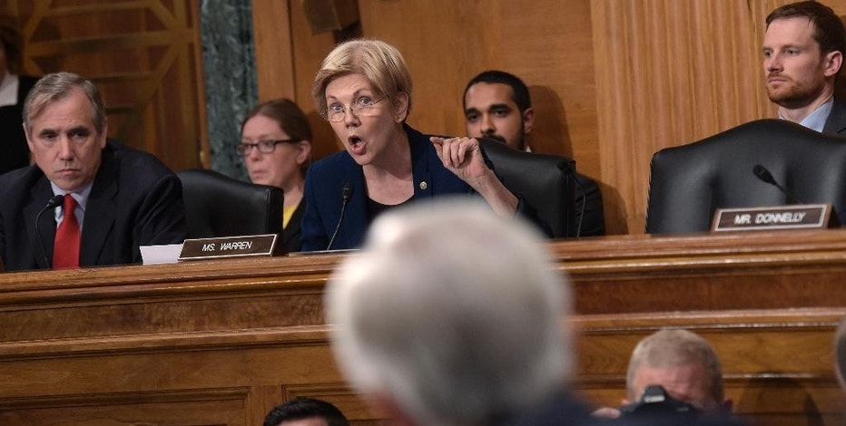 Senate Banking Committee member Sen. Elizabeth Warren, D-Mass., center, questions Wells Fargo Chief Executive Officer John Stumpf, on Capitol Hill in Washington, Tuesday, Sept. 20, 2016, during the committee's hearing. Stumpf was called before the committee for betraying customers' trust in a scandal over allegations that employees opened millions of unauthorized accounts to meet aggressive sales targets. (AP Photo/Susan Walsh)