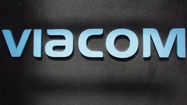Interim Viacom CEO to leave, dividend slashed