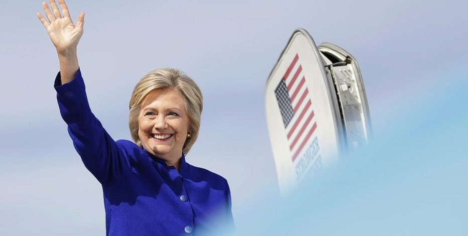 Democratic presidential candidate Hillary Clinton waves as she boards her campaign plane at Westchester County Airport in White Plains, N.Y., Wednesday, Sept. 21, 2016. (AP Photo/Matt Rourke)