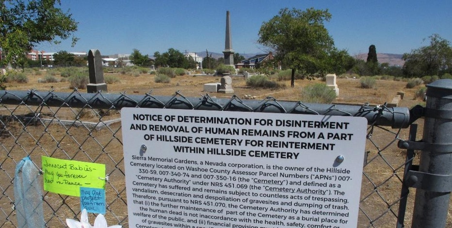 """In this Sept. 8, 2016 photo, a sign hangs on the fence that reads """"Notice of determination for disinterment and removal of human remains"""" in Reno, Nev., at Hillside Cemetery. The owners posted the notice, secured health permits to move remains and alerted family members in recent weeks in accordance with a state law known as the Cemetery Authority Act. Reno residents and heirs of the dead are outraged, calling the cemetery a Nevada historical treasure that should not be disturbed. (AP Photo/Scott Sonner)"""