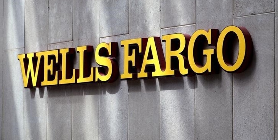 The sign outside the Wells Fargo & Co. bank in downtown Denver April 13, 2016.  REUTERS/Rick Wilking