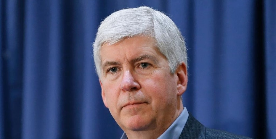 FILE - In this Feb. 26, 2016, file photo, Michigan Gov. Rick Snyder listens to a question after attending a Flint Water Interagency Coordinating Committee meeting, in Flint, Mich. Tesla Motors Inc. filed a federal lawsuit, Thursday, Sept. 22, 2016, against Snyder and other state officials, challenging a 2014 law that ensures automakers can only sell through franchised dealerships.  (AP Photo/Paul Sancya, File)