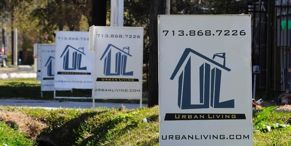 """FILE - In this Tuesday, Feb. 16, 2016, photo, """"For Sale"""" signs are stacked up outside a new complex of townhouses in Houston. On Thursday, Sept. 22, 2016, Freddie Mac reports on the week's average U.S. mortgage rates. (AP Photo/Pat Sullivan, File)"""