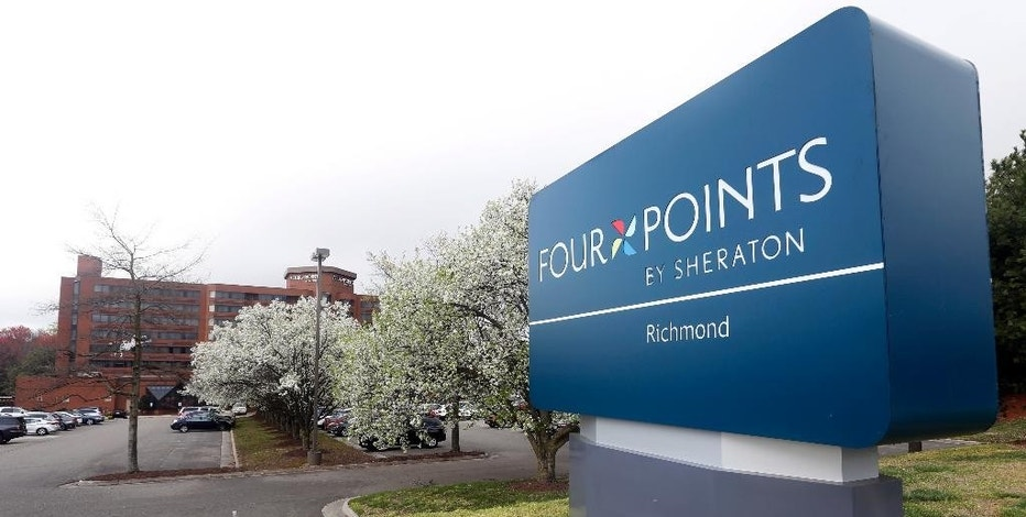 This Friday, March 25, 2016, photo shows the sign at the Four Points Sheraton Hotel in Richmond, Va. Marriott International closed early Friday, Sept. 23, 2016, on its acquisition of Starwood Hotels & Resorts Worldwide, bringing together its Marriott, Courtyard and Ritz-Carlton brands with Starwood's Sheraton, Westin, W and St. Regis properties. (AP Photo/Steve Helber)