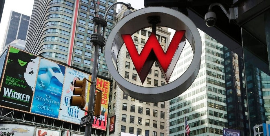 FILE - In this Wednesday, July 31, 2013, file photo, the logo for the W Hotel, owned by Starwood Hotels & Resorts Worldwide, is seen in New York's Times Square. Marriott International closed early Friday, Sept. 23, 2016, on its acquisition of Starwood Hotels & Resorts Worldwide, bringing together its Marriott, Courtyard and Ritz-Carlton brands with Starwood's Sheraton, Westin, W and St. Regis properties. (AP Photo/Mark Lennihan, File)
