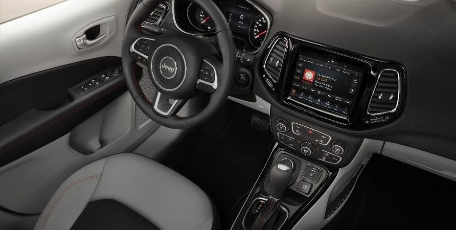 This undated photo provided by Fiat Chrysler Automobiles US LLC shows the interior of the redesigned Jeep Compass Limited SUV. The new Compass, unveiled at a factory in Brazil on Monday, Sept. 26, 2016, replaces a model that was introduced about a decade earlier and had fallen far behind rivals in what is now the largest segment of the U.S. auto market. It also will replace the Jeep Patriot, a similar-sized SUV. (Fiat Chrysler Automobiles US LLC via AP)