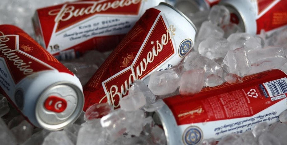FILE - In this Thursday, March 5, 2015, file photo, Budweiser beer cans are on ice at a concession stand at McKechnie Field in Bradenton, Fla. On Wednesday, Sept. 28, 2016, it was announced that Budweiser maker Anheuser-Busch InBev will pay $6 million to the Securities and Exchange Commission to settle charges that the company made improper payments to government officials in India to promote its products and then tried to hush an employee who reported the violations. (AP Photo/Gene J. Puskar, File)