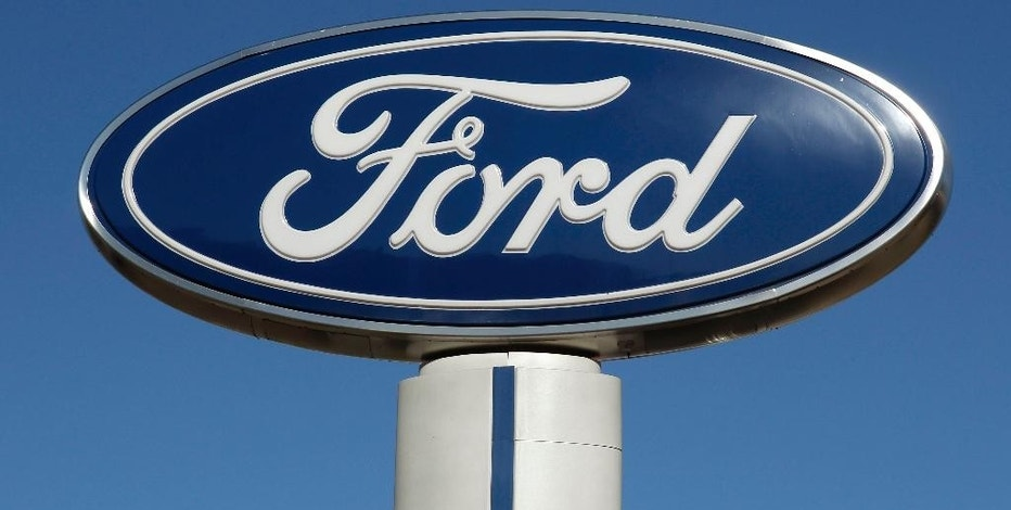 FILE - This Tuesday, Oct. 25, 2011, file photo shows a Ford sign at the Salem Ford dealership in Salem, N.H. Ford announced Wednesday, Sept. 28, 2016, that the company is recalling about 74,000 Focus hatchback cars with manual transmissions in the U.S. and Canada because the hatches can be unlatched too easily while the cars are moving. (AP Photo/Charles Krupa, File)