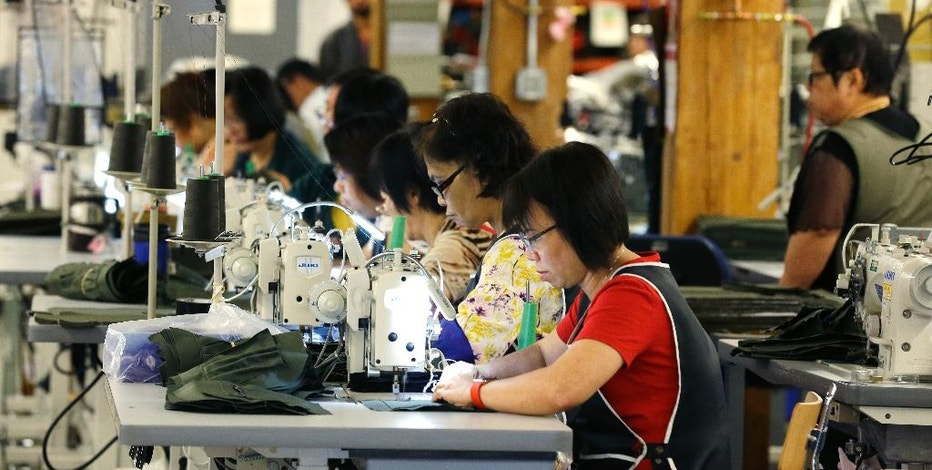 In this Wednesday, Aug. 31, 2016, photo, a group of workers at the C.C. Filson Co. manufacturing facility work at their sewing machines, in Seattle. The United States isn't exactly the economic doormat that Republican presidential candidate Donald Trump decries in his campaign rhetoric. America has outperformed other advanced economies and ranks among the world's most competitive countries. (AP Photo/Ted S. Warren)