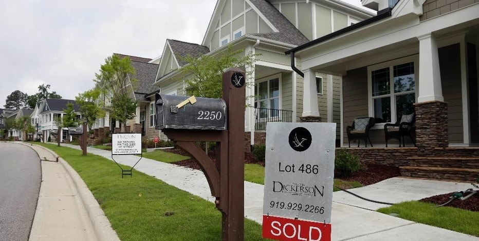 "FILE - In this Tuesday, June 9, 2015, file photo, a ""Sold"" sign is displayed in the yard of a newly-constructed home in the Briar Chapel community in Chapel Hill, N.C. On Thursday, Sept. 29, 2016, Freddie Mac reports on the week's average U.S. mortgage rates. (AP Photo/Gerry Broome, File)"