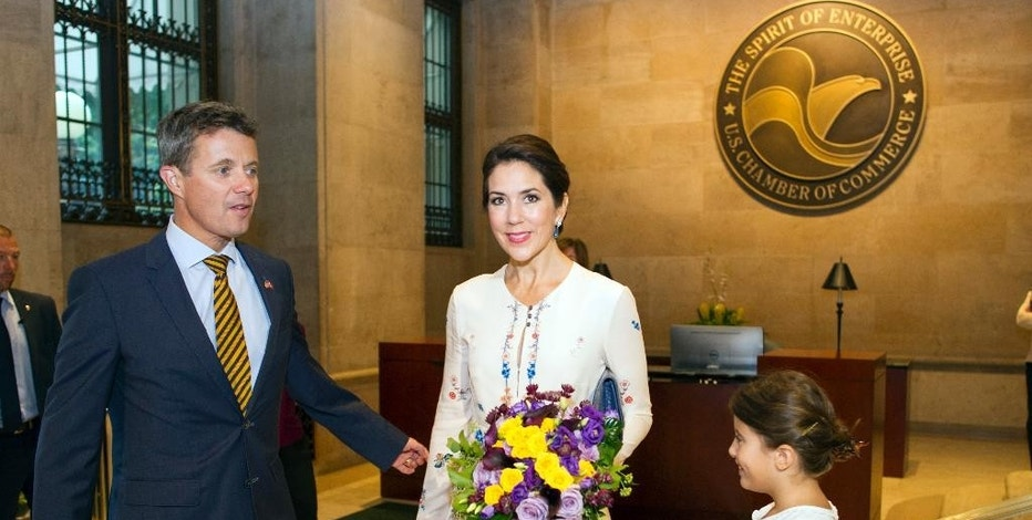 "FILE - In this Wednesday, Sept. 28, 2016 file photo, Crown Prince Frederik of Denmark and his wife Crown Princess Mary arrive at the U.S. Chamber of Commerce in Washington, for the opening of the U.S. Denmark Trade Mission. At right is Mia Heltberg, 7, who presented Princess Mary with flowers. Crown Prince Frederik and his wife Mary are kicking off a two-day trade mission to Boston. On Thursday, Sept. 29, Frederik is scheduled to join Democratic Boston Mayor Marty Walsh for an event at Boston University highlighting ways to promote urban sustainability and climate resilience, including ways to ""future-proof"" cities. (AP Photo/Cliff Owen, File)"