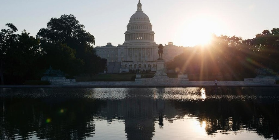 This Wednesday, Oct. 2, 2013 photo shows the Capitol building reflected in the Capitol Reflecting Pool at sunrise in Washington. The 2016 presidential campaign has underscored an economic paradox: Financially, black Americans and Hispanics are far worse off than whites, yet polls show minorities are more likely than whites to believe in the American Dream. And they are less anxious about the outcome of the election. (AP Photo/Carolyn Kaster)