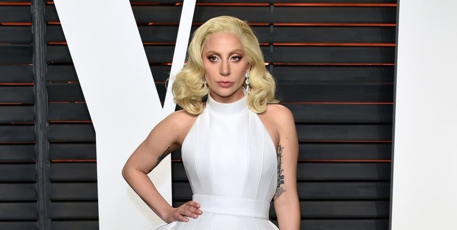 FILE - In this Feb. 28, 2016 file photo, Lady Gaga arrives at the Vanity Fair Oscar Party in Beverly Hills, Calif. Lady Gaga will be featured on Volume, a new SiriusXM talk channel devoted to music, debuting on Oct. 17. (Photo by Evan Agostini/Invision/AP, File)