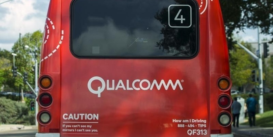 A Qualcomm company bus used to transport employees among its many buildings is shown in San Diego, California  November 3, 2015.    REUTERS/Mike Blake