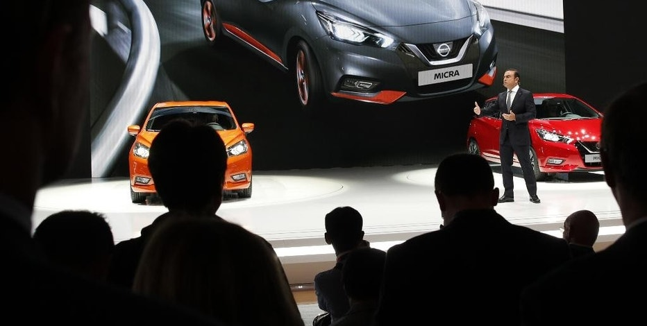 Nissan Motor Co. President and CEO Carlos Ghosn adresses the media during the presentation of the new Nissan Micra as part of the first press day at the Paris Auto Show in Paris, France, Thursday, Sept. 29, 2016. The Paris Auto Show will open its gates to the public from Oct. 1st to 16th. (AP Photo/Christophe Ena)