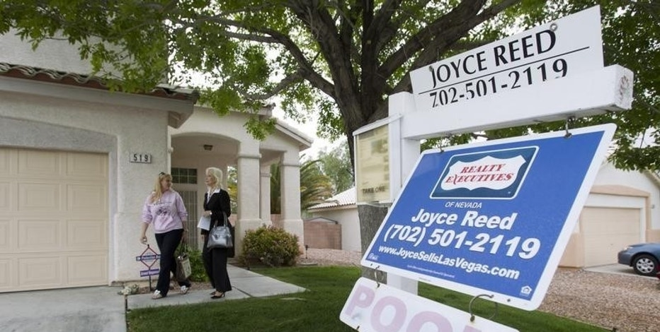 Realtor Helen Riley (L) and Fafie Moore, a Reality Executives owner/broker, leave a home being offered for sale in Henderson, Nevada April 8, 2013.    REUTER/Steve Marcus