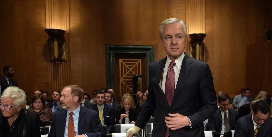 FILE - In this Tuesday, Sept. 20, 2016, file photo, Wells Fargo CEO John Stumpf arrives to testify before the Senate Banking Committee, on Capitol Hill in Washington. Stumpf, newly stripped of tens of millions of dollars in compensation in a scandal over sales practices, is scheduled to appear before the House Financial Services Committee on Thursday, Sept. 29. (AP Photo/Susan Walsh, File)