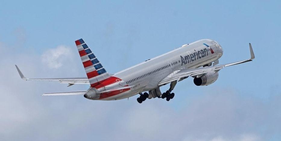 In this Friday, June 3, 2016, photo, an American Airlines passenger jet takes off from Miami International Airport in Miami. Nearly three years after its merger with US Airways, American Airlines will roll out a flight system covering all its pilots, the airline announced Friday, Sept. 30, 2016. American hopes it can make the change on the fly during the weekend without causing delays or canceling more flights. The airline dropped about 200 flights for the weekend to lighten its load and make the switchover easier. (AP Photo/Alan Diaz)