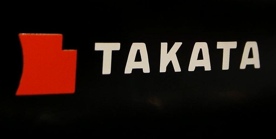 FILE - This July 6, 2016, file photo, shows the logo of Takata Corp. at an auto supply shop in Tokyo. BMW is recalling 4,000 SUVs in the U.S. and Canada to fix a new and potentially deadly problem with Takata air bag inflators. The company says in government documents that the driver's front inflator can separate from a plate, shooting out metal and other debris. Dealers will replace the driver's air bag at no cost starting Nov. 11, 2016. (AP Photo/Shizuo Kambayashi, File)