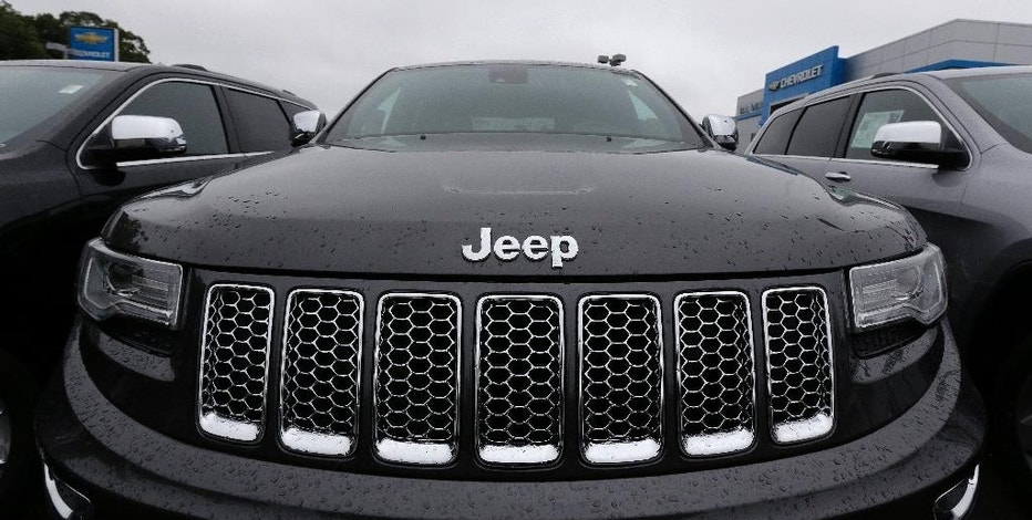 FILE - In this Oct. 1, 2014, file photo, a Jeep Grand Cherokee sits on the lot at Bill DeLuca's dealerships in Haverhill, Mass. U.S. safety regulators have closed an investigation into the Jeep Grand Cherokee's automatic braking system without seeking a recall. The National Highway Traffic Safety Administration began the probe in June 2015 after getting complaints that the system braked for no reason, increasing the risk of rear crashes. The investigation covered just over 95,000 SUVs from the 2014 and 2015 model years. The agency says tests found that the braking reduced the SUV speeds by less than 3 mph. (AP Photo/Charles Krupa, File)