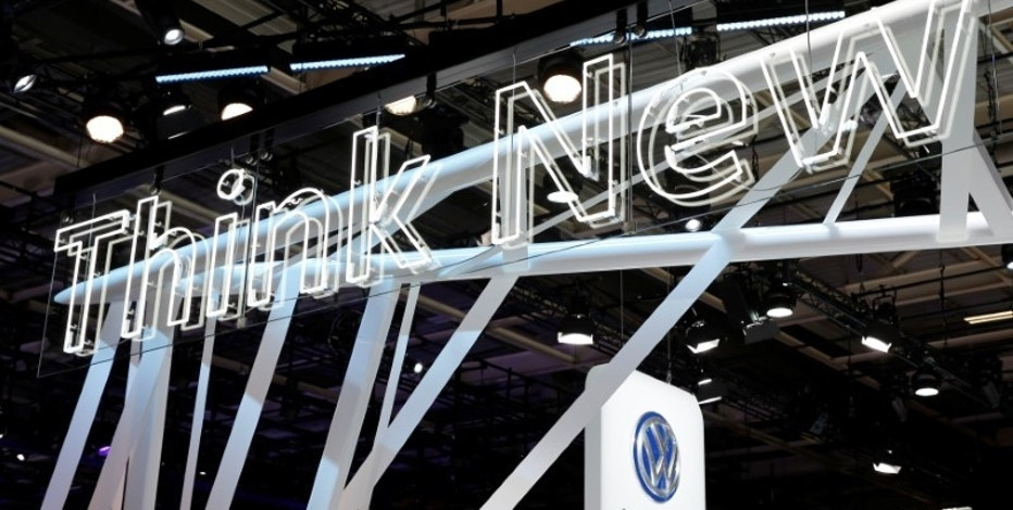 "A lighted billboard reads ""Think New"" at the introduction of the new Volkswagen electric car on media day at the Paris auto show, in Paris, France, September 30, 2016. REUTERS/Benoit Tessier"