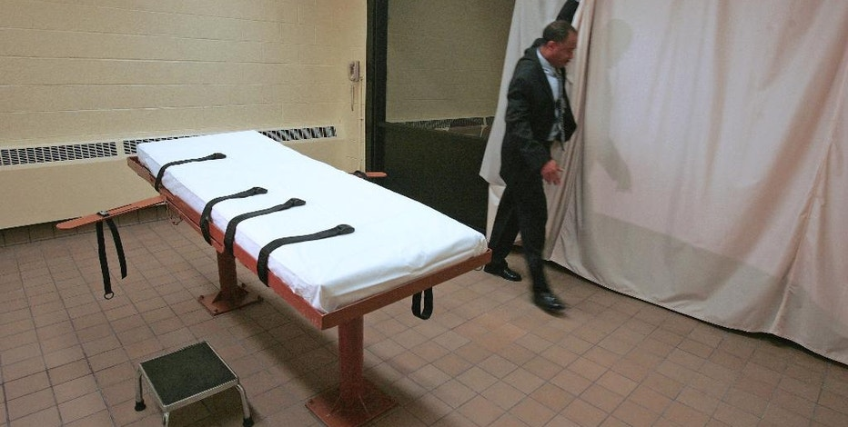 FILE – In this November 2005 file photo, Larry Greene, public information director of the Southern Ohio Correctional Facility, demonstrates how a curtain is pulled between the death chamber and witness room at the prison in Lucasville, Ohio. Ohio plans to resume executions in January 2017 with a new three-drug combination, an attorney representing the state told a federal judge Monday, Oct. 3, 2016. (AP Photo/Kiichiro Sato, File)