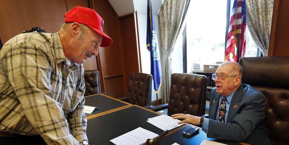 Farmer Tom Marsoton, of Pittsfield, N.H., left, talks with Republican Rep. Bob Haefner, of Hudson, chairman of the Milk Producers Emergency Relief Fund Board, Monday, Oct. 3, 2016, in Concord, N.H. The board is trying to see what can be done quickly as farmers struggle with low milk prices and drought conditions. Nineteen of the state's 120 dairies have closed in recent months. (AP Photo/Jim Cole)