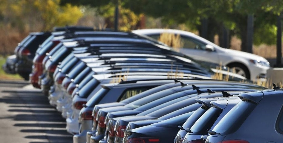 FILE - In this Thursday, Sept. 24, 2015, file photo, Volkswagen cars for sale are on display on the lot of a VW dealership in Boulder, Colo. On Monday, Oct. 3, 2016, automakers release vehicle sales for September. (AP Photo/Brennan Linsley, File)