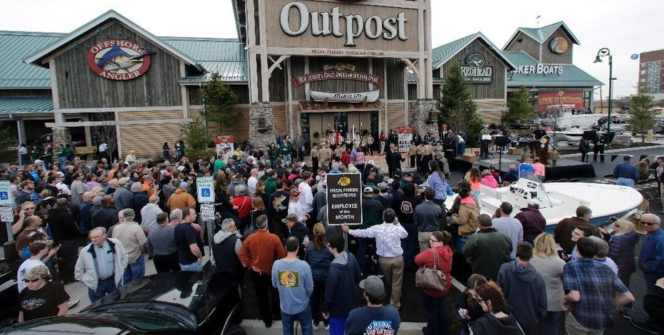 FILE - In this Wednesday, April 15, 2015, file photo, a large crowd of people line up as they wait for the grand opening of Bass Pro Shops Outpost store in Atlantic City, N.J. Outdoor gear giants Bass Pro and Cabela's will combine in a $4.5 billion deal announced Monday, Oct. 3, 2016. (AP Photo/Mel Evans, File)