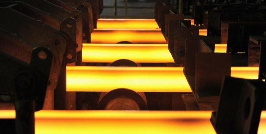 Red hot steel bars are seen inside a foundry at a steel factory in Concepcion city, south of Santiago, December 9, 2014. Picture taken December 9, 2014. REUTERS/Jose Luis Saavedra