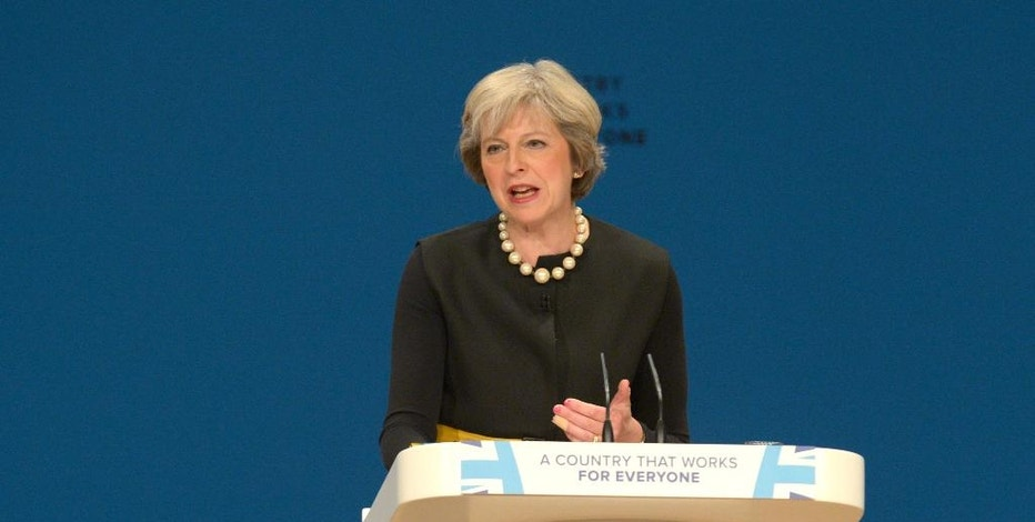 Britain's Prime Minister Theresa May gives a speech at the Conservative Party Conference in Birmingham, England, Sunday Oct. 2, 2016.  Britain will trigger the formal process for leaving the European Union before April 2017, May said Sunday, putting to rest weeks of speculation on the timing of the move. (Ben Birchall / PA via AP)