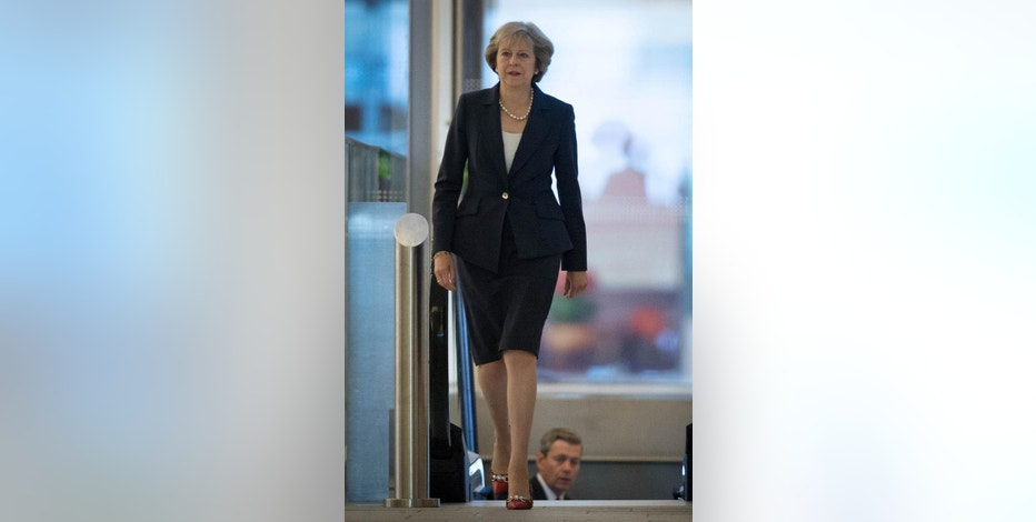 Britain's Prime Minister Theresa May arrives ahead of a TV interview at BBC studios in Birmingham, England, before the start of the annual Conservative party conference, Sunday Oct. 2, 2016.  During the interview May said Britain will trigger the Article 50 formal process for leaving the European Union, Brexit, before the end of March 2017, setting the nation on a course to leave the 28-nation European trading bloc by 2019. (Stefan Rousseau / PA via AP)