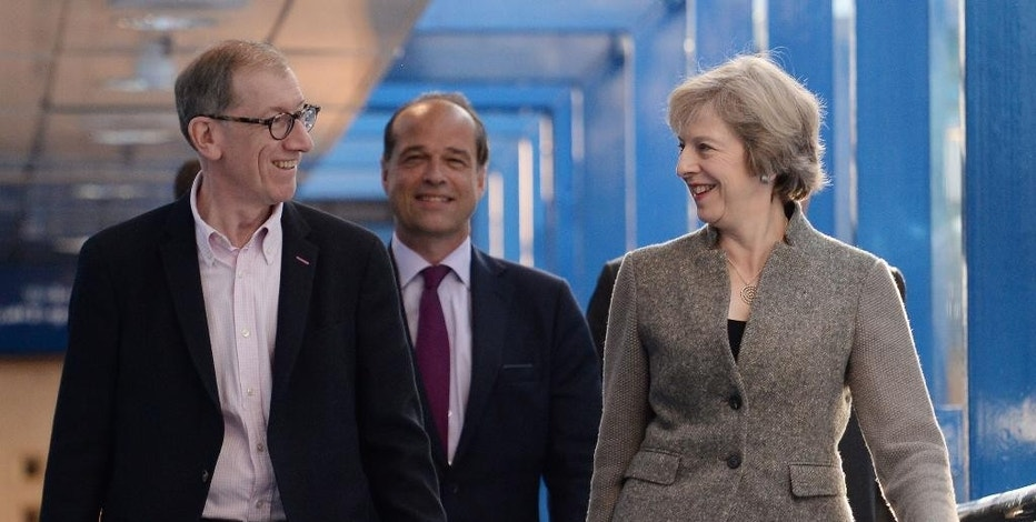 Britain's Prime Minister Theresa May, right, and her husband Philip May, arrive on the second day of the Conservative Party Conference in Birmingham, England, Monday Oct. 3, 2016.  Theresa May announced Sunday a timetable for Britain's exit from the European Union. (Stefan Rousseau / PA via AP)