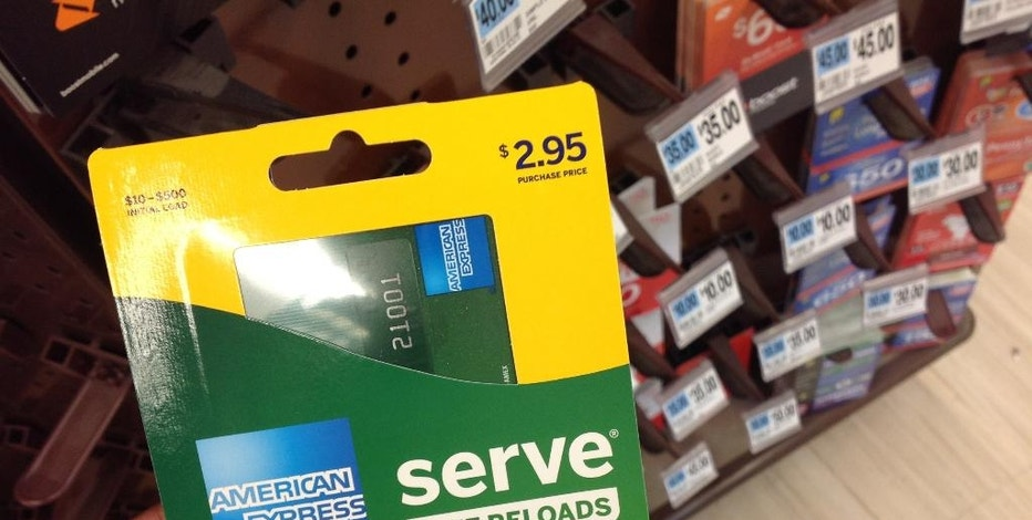 This Monday, March 7, 2016, photo, shows an American Express Serve prepaid debit card for sale at a store, in New York. Federal regulators announced new rules Wednesday, Oct. 5, 2016, governing the quickly growing prepaid debit card industry, an effort more than two years in the making, which should bring basic account protections to its customers that are often the poor and financially disadvantaged. (AP Photo/Swayne B. Hall)