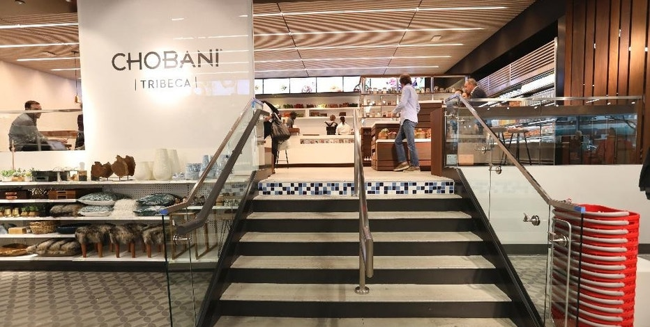 This Tuesday, Oct. 4, 2016, photo provided by Target shows the Chobani Cafe at a new Target store in Manhattan's Tribeca area, in New York. The discounter opened the store, which is one-third the size of its regular stores, on Wednesday, Oct. 5. It's part of a strategy to open dozens of small stores in the U.S. that are customized to college towns and dense urban markets. (Target via AP)