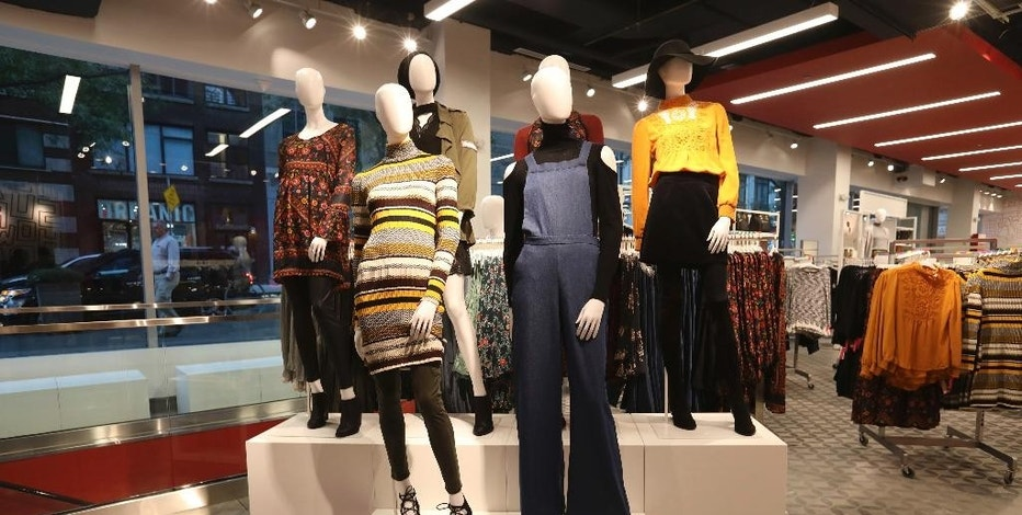 This photo provided by Target shows a women's clothing display at a new Target store in Manhattan's Tribeca area, Wednesday, Oct. 5, 2016, in New York. The discounter opened the store, which is one-third the size of its regular stores, on Wednesday. It's part of a strategy to open dozens of small stores in the U.S. that are customized to college towns and dense urban markets. (Target via AP)