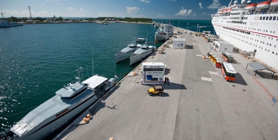 In this photo provided by the Florida Keys News Bureau, Royal Bahamas Defence Force vessels take refuge from Hurricane Matthew Wednesday, Oct. 5, 2016, at the U.S. Navy's Truman Harbor pier in Key West, Fla. Key West is the only city in Florida, that fronts on the Atlantic Ocean not under a tropical cyclone watch or warning due to Matthew. At right is Carnival Cruise Line's Carnival Elation, originally scheduled to be in the Bahamas, but diverted to Key West because of the storm. (Rob O'Neal/Florida Keys News Bureau via AP)