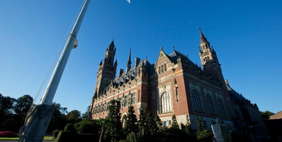 Exterior view of the Peace Palace, also known as the World Court, in The Hague, Netherlands, Wednesday, Oct. 5, 2016. The Marshall Island are taking India, Pakistan and the U.K. to court Wednesday to urge those powers to resume negotiations to eradicate the world's nuclear stockpile. (AP Photo/Peter Dejong)