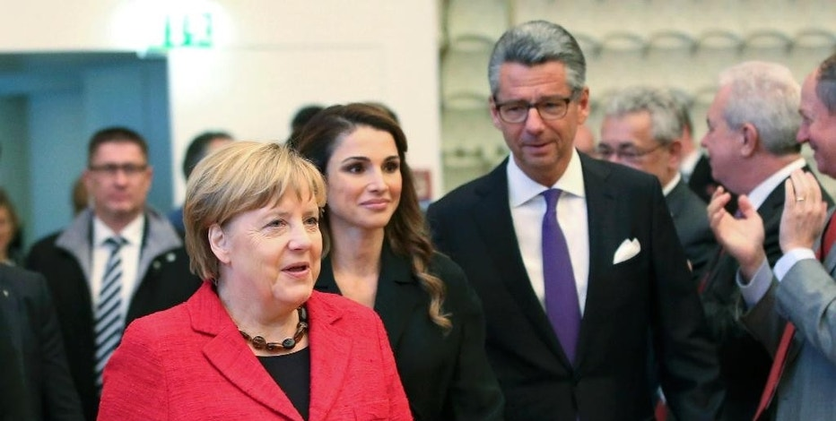 German Chancellor Angela Merkel, left, Jordanian Queen Rania, center, and Federation of German Industry (BDI) President Ulrich Grillo attend the Day of German Industry 2016 conference in Berlin, Germany, Thursday, Oct. 6, 2016. (Fabrizio Bensch/Pool Photo via AP)