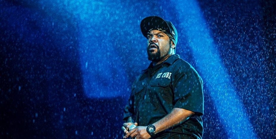 "FILE - In this July 9, 2016 file photo, Ice Cube performs at the 2016 Festival d'ete de Quebec in downtown Quebec City, in Canada. Ice Cube's music is coming straight onto a video game. Cube and producer DJ Shadow created the original song ""Nobody Wants to Die"" for 2K's ""Mafia III"" launch trailer, which premieres Thursday, Oct. 6, 2016. (Photo by Amy Harris/Invision/AP, File)"