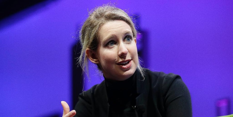 FILE - In this Nov. 2, 2015, file photo, Elizabeth Holmes, founder and CEO of Theranos, speaks at the Fortune Global Forum in San Francisco. Holmes announced Oct. 6, 2016, that Theranos will close its labs and wellness centers and lay off about 340 employees in Arizona, California and Pennsylvania. (AP Photo/Jeff Chiu, File)