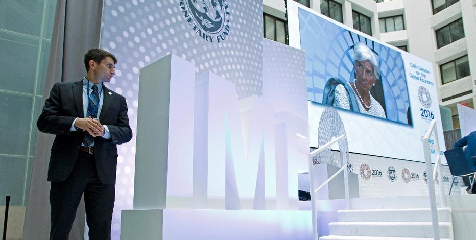International Monetary Fund (IMF) Managing Director Christine Lagarde is seen on a video screen as she speaks at CNN Debate on the Global Economy during World Bank/IMF Annual Meetings at IMF headquarters in Washington, Thursday, Oct. 6, 2016. ( AP Photo/Jose Luis Magana)