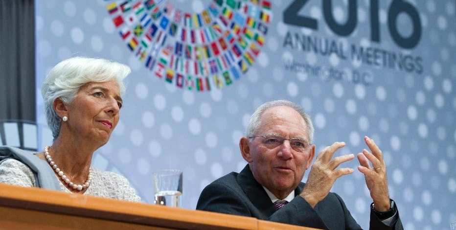 International Monetary Fund (IMF) Managing Director Christine Lagarde, left, and Germany's Finance Minister Wolfgang Schauble speak at CNN Debate on the Global Economy during World Bank/IMF Annual Meetings at IMF headquarters in Washington, Thursday, Oct. 6, 2016. ( AP Photo/Jose Luis Magana)