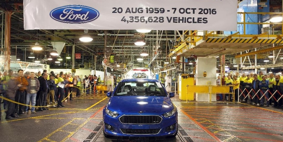 In this hand out photo supplied by Ford Motor Co. Australia, the world's last six-cylinder, rear-wheel drive Falcon XR6 rolls off the assembly line at Ford Motor's Broadmeadows plant in Melbourne, Australia, Friday, Oct 7, 2016. Ford ended 91 years of car manufacturing in Australia with 600 employees loosing their jobs. The remaining two Australian car makers due to close their doors next year. (Ford Motor Co. via AP)