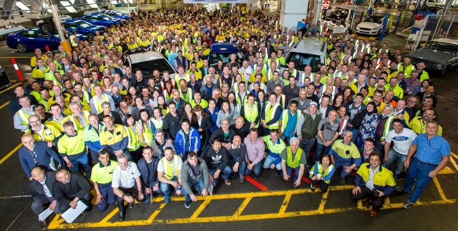 In this photo supplied by Ford Motor Co. Australia, Ford Motor Co. employees gather around the world's last six-cylinder, rear-wheel drive Falcon XR6 to pose for a photo after it rolled off the assembly line at its Broadmeadows plant in Melbourne, Australia, Friday, Oct. 7, 2016. Ford ended 91 years of car manufacturing in Australia Friday, with the remaining two Australian car makers due to close their doors next year. (Ford Motor Co. via AP)
