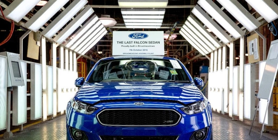In this hand out photo supplied by Ford Motor Co. Australia, the world's last six-cylinder, rear-wheel drive Falcon XR6 rolls off the assembly line at Ford Motor's Broadmeadows plant in Melbourne, Australia, Friday, Oct. 7, 2016. Ford ended 91 years of car manufacturing in Australia Friday, with the remaining two Australian car makers due to close their doors next year. (Ford Motor Co. via AP)